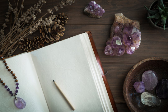 Open Journal or Notebook Surrounded by Amethyst Crystals Dried Lavender and Succulent Plant