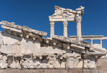 Detail of temple of Trajan at Pergamon, historical artifacts, columns, blue sky Bergama, İzmir, Turkey
