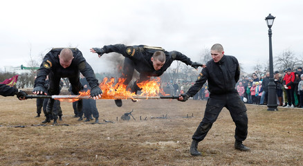 Servicemen of the Belarusian Interior Ministry's special forces perform as they mark Internal Forces Day in Minsk