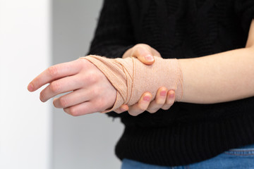 Girl with a bandage on her wrist