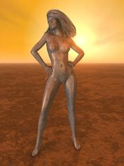 Skulptur einer Frau in einer Landschaft bei Sonnenuntergang