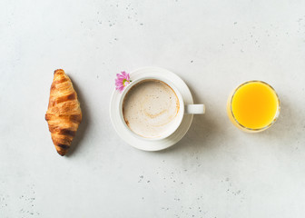 Breakfast concept with cup of coffee, croissants and flower on white background Wall mural