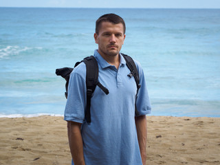 A man on the beach. Atlantic ocean background.
