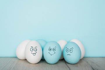 Painted Eggs with cute hand drawn funny faces. Happy easter card concept.