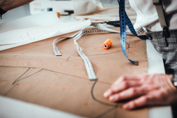 Fashion designer desk with equipment, tailoring and sewing workshop concept