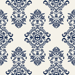 Indigo dye woodblock printed seamless ethnic floral all over pattern. Traditional oriental ornament of India with exotic flowers of Kashmir, navy blue on ecru background. Textile design.