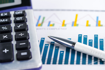 Calculator on chart and graph paper. Finance development, Banking Account, Statistics, Investment Analytic research data economy, Stock exchange trading, Business company concept.