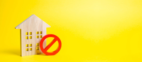 Wooden house figurine and a red symbol NO or ban. inaccessibility or lack of housing. There is no opportunity to buy a house or pay for rent. The house can not be put into operation. Banner