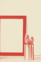mock up frame with cactus in metal pot on the cement grey floor and empty background with copy space for text or desing Coral duotone