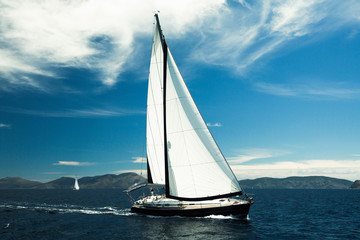 Wall Mural - Sailing yacht boat in the Sea. Luxury Yachts for vacation.