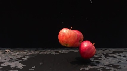 Fototapete - Red apples fall down to the floor in Slow Motion