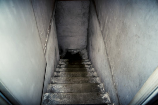The descent to the basement of the old concrete stairs.