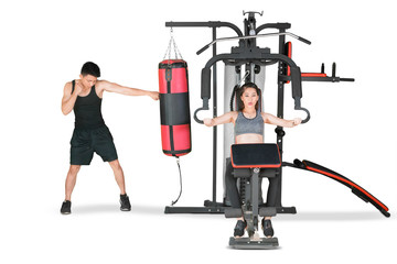 Asian couple doing workout on weight machine