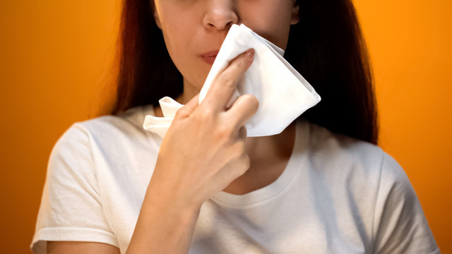 Girl wiping face with napkin after eating, hygiene and etiquette, happy client