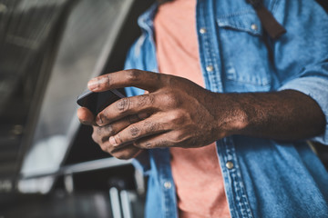 Selective focus of a smartphone in hands of male hands