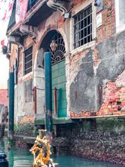 Deurstickers Wood door and window. On redbrick wall, building facade in Venice, exterior design