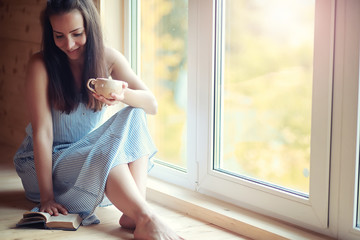 A girl at the window in the house