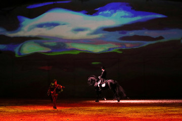 "A horse and artists perform during a show ""Cavalluna, World of Fantasy"", in Brussels"