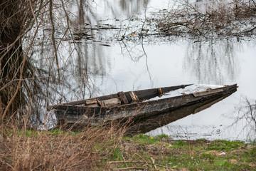 Danube island (Šodroš) near Novi Sad, Serbia. Submerged and damaged boat.