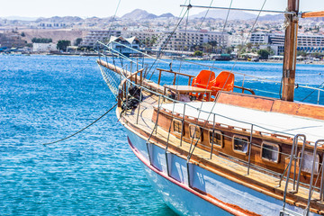 beautiful summer city harbor and yacht on a vivid blue water surface, cruise vacation and renting concept travel photography