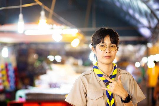 Asian woman in scouting uniform