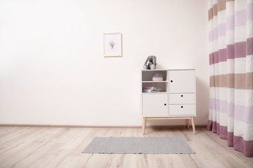 Interior of modern child room with cabinet. Space for text