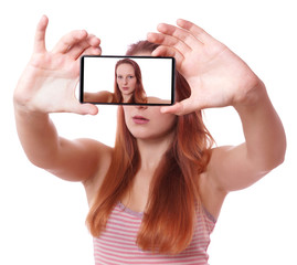 young woman taking selfie with smart phone