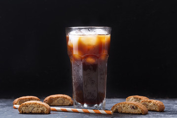 glass of iced coffee with cookies