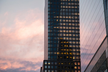 New York City / USA - AUG 22 2018: One World Trade Center exterior reflection at sunset in Lower Manahttan
