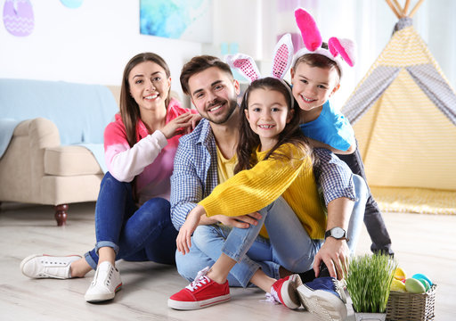 Happy family spending time together during Easter holiday at home