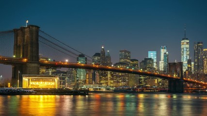 Wall Mural - Panoramic view of Brooklyn bridge and Manhattan at sunrise, New York City. Time lapse of night to day transition.