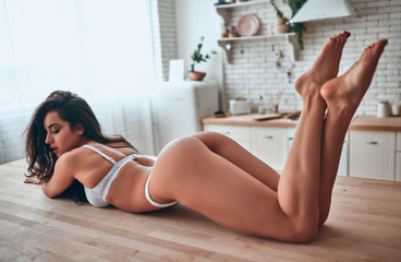 Sexy woman on kitchen