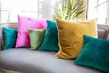 Couch with assorted jewel tone pillows
