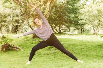 Active healthy woman exercise in park at summer