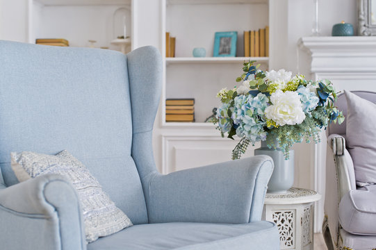 Vase of flowers on the table in the room. Stylish interior background.