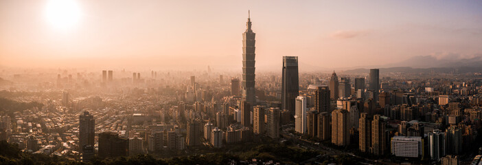 Aerial drone panorama photo - Sunset over the city of Taipei, Taiwan.  Taipei 101 skyscraper featured.   Wall mural