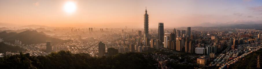 Aerial drone panorama photo - Sunset over the city of Taipei, Taiwan.  Taipei 101 skyscraper featured.   Wall mural
