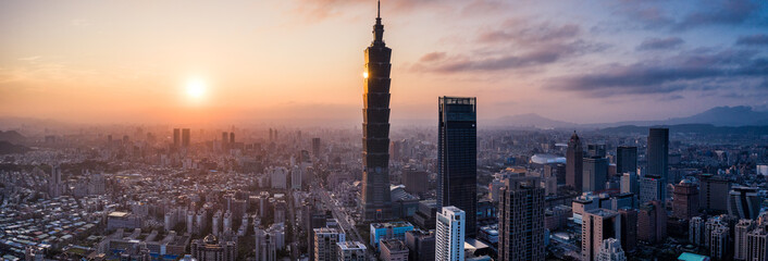 Aerial drone panorama photo - Sunset over the city of Taipei, Taiwan.  Taipei 101 skyscraper featured.   Fotomurales