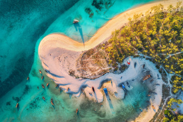 Printed kitchen splashbacks Zanzibar Aerial view of the fishing boats on tropical sea coast with sandy beach and palms at sunset. Fishing village on Indian Ocean, Zanzibar, Africa. Landscape with boat, trees, clear blue water. Top view