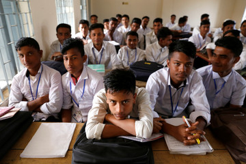 Bangladeshi students from the class where Rohingya students were expelled by the authorities are seen at Leda high school, Cox's Bazar