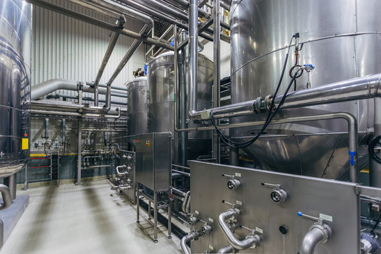 Industrial stainless steel vats in modern brewery