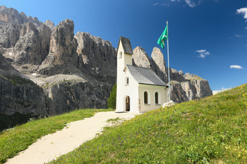 Gardena Pass, view of the church and mountains of Sella Group, Italy