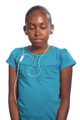 Girl eyes closed earphones in listening to music