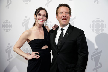 Tessa Virtue poses with Rick Mercer backstage at the 2019 Juno Awards in London, Ontario, Canada