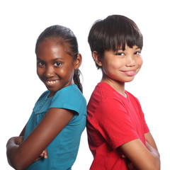 Multi-racial boy and girl back to back arms folded