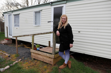 Romanian worker, Gabriela Serbanescu poses for a photograph outside her accommodation at Cobrey Farm in Ross-on-Wye
