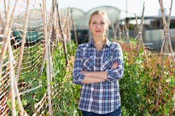 Girl in working wear at her garden