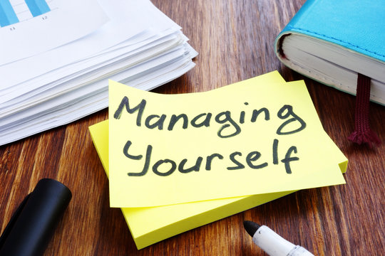 Managing yourself. Office table with papers. Self management concept.