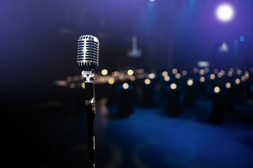 stylish 50s or 60s retro rock microphone on an empty venue stage. Vintage mic at a live band show