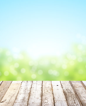 Wooden table top on blurred nature background